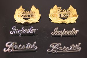A selection of Bristol Omnibus Inspector,Senior Inspector and normal Bristol scroll badges.